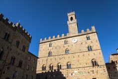 Volterra town central square, medieval palace Palazzo Dei Priori landmark Stock Image
