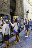 Volterra, Tuscany, tourists choosing postcards. Color image Royalty Free Stock Photography