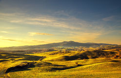 Volterra winter panorama, rolling hills and green fields on suns Stock Photography