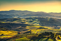 Volterra winter panorama, rolling hills and green fields on suns Stock Images
