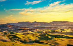Volterra winter panorama, rolling hills and green fields on suns Royalty Free Stock Photo