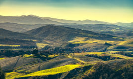 Volterra winter panorama, rolling hills and green fields on suns Royalty Free Stock Photography