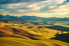 Volterra winter panorama, rolling hills and green fields on suns Royalty Free Stock Photos