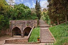 Volterrra, Pisa, Tuscany, Italy: the ancient Fonte di Docciola,. A fount built in 1254 at the entrance of the old town and the staircase that leads to the Royalty Free Stock Images