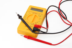 Voltmeter. An yellow digital voltmeter against a white background royalty free stock image