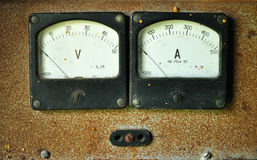 Voltmeter and amperemeter. The old used analog voltmeter and amperemeter stock photo