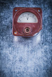 Voltmeter on scratched metallic background vertical view vintage Royalty Free Stock Images