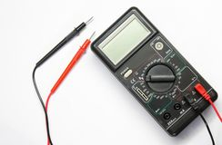 Voltmeter on white background. Black voltmeter on isolated on white background closeup with wires stock photos