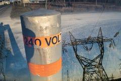 240 Volts pole & Pylon double exposure Stock Images