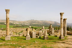 Volubilis Capitol. Volubilis is the best preserved Roman site in Morocco, and features some brilliant mosaics. It was declared a UNESCO World Heritage site in Royalty Free Stock Photo