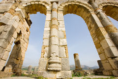 Volubilis Capitol. Volubilis is the best preserved Roman site in Morocco, and features some brilliant mosaics. It was declared a UNESCO World Heritage site in Stock Photo