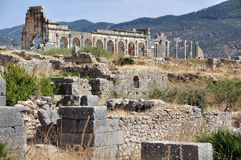 Volubilis Capitol with stones at the forefront Royalty Free Stock Photos