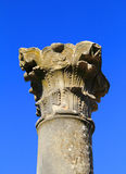 Volubilis - Roman archaeological site, Morocco. Morocco, Moulay Idriss, Volubilis - Roman archaeological site, detail of anintricately carved column. UNESCO royalty free stock photo