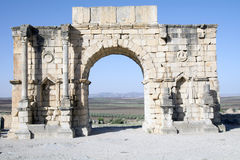 Volubilis Roman empire city in Morocco, Africa. Volubilis (Berber: Walili, Arabic: وليلي‎‎) is a partly excavated Berber and Roman city in Morocco Stock Image