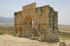 Volubilis, the triumphal arch. This arch was build by the Roman emperor Caracalla in the year 217 stock photos