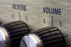 Volume. Detail of an golden electric guitar amplifier Stock Photos