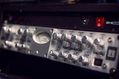 Electric guitar amplifier audio equipment with knobs stock images