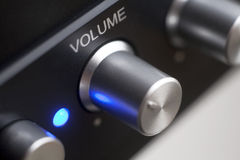 Volume control. Adjusted to a third stock image