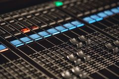 Volume control. Close-up view of sound console buttons for volume setting in sound recording studio. Equipment for sound recordings stock images
