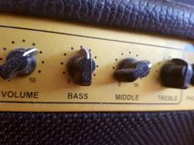 Volume control. Dusty volume control - bass, treble, middle, volume - for guitar Royalty Free Stock Images