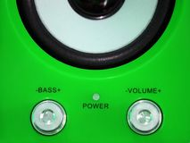 Volume control on a green background Stock Images