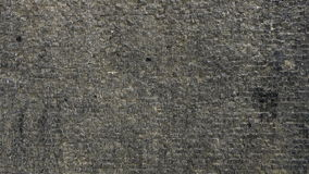 Volume de água na textura do fundo da parede de pedra do tijolo filme