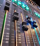 Volume faders on a digital sound board royalty free stock image
