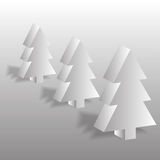 Volume fir-trees. On a gray background Royalty Free Stock Photography