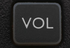 Volume key from old cell phone. Close up of volume key from old cell phone Royalty Free Stock Photos