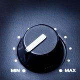 Volume Knob. Black olume knob on minimum, close up royalty free stock photo