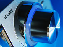 Volume Knob. A view of a metallic volume knob of a music system, lit in blue light Royalty Free Stock Photos