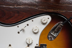 Volume and tone adjusting buttons on electric guitar Royalty Free Stock Images