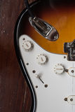 Volume and tone adjusting buttons on electric guitar Royalty Free Stock Photo