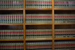 Volumes of books on bookshelf in library Royalty Free Stock Images