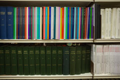 Volumes of books on bookshelf in library Stock Photography