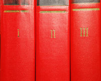 Volumes of old books with gold lettering on the cover Stock Photos