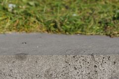 Volumetric background of green grass and concrete. royalty free stock photo