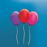 Volumetric balloons. On a blue background Stock Photos