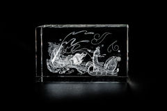 Volumetric laser engraving inside the glass. Stock Image