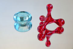 Volumetrical geometrical figure. Prism and toroid with glass reflection stock image