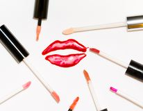 Voluminous sparkling painted lips and a lot of lip gloss brushes. Voluminous sparkling painted lips and a lot of lip gloss brushes Royalty Free Stock Photos