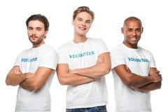 Voluntários consideráveis com braços cruzados foto de stock
