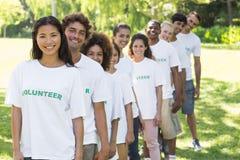 Voluntários seguros que estão em uma linha Foto de Stock Royalty Free