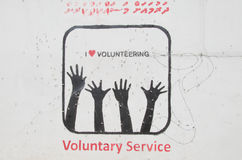 Voluntary Service graffiti on wall Stock Images