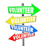 Volunteer Arrow Signs Share Donate Time Charity Work. Volunteer word on arrow signs pointing you to different ways or places to donate your time to charity work Stock Photography