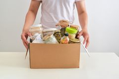 Volunteer with box of food for poor. Donation concept. royalty free stock photo