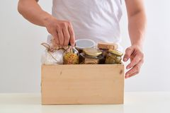Volunteer with box of food for poor. Donation concept. stock photos