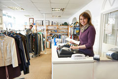 Volunteer In Charity Shop With Customer Royalty Free Stock Photo