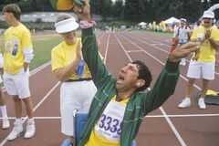 Volunteer cheering with handicapped athlete. Special Olympics, UCLA, CA Royalty Free Stock Photography