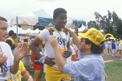 Volunteer coaching handicapped athlete. Special Olympics, UCLA, CA Royalty Free Stock Photography